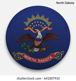 Round glossy Button with flag of North Dakota, state of the USA, with the reflection of light and shadow realistic.