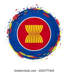 Round grunge flag of ASEAN with splashes in flag color. Vector illustration.