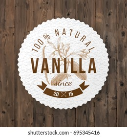 Round label with type design and hand drawn vanilla plant in vintage style