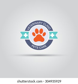 Round label for veterinary clinic with dog paw print and sample text, isolated vector logo template