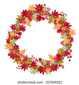 Round season wreath with autumn leaves and berries   isolated on white.
