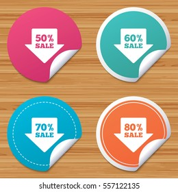 Round stickers or website banners. Sale arrow tag icons. Discount special offer symbols. 50%, 60%, 70% and 80% percent sale signs. Circle badges with bended corner. Vector