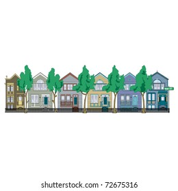 Row of Victorian style houses on a street or in a neighborhood.