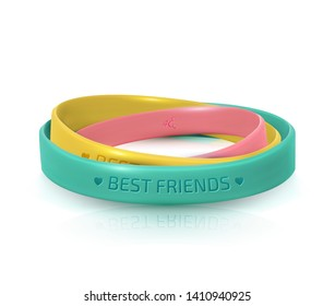 Rubber bracelets for best friends. Friendship Day background, happy holiday of amity. Three multicolored silicone wristbands on white background