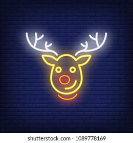 Rudolph neon Christmas reindeer cartoon character. Night bright advertisement element. Neon festive design for New Year, Christmas, celebration, greeting cards