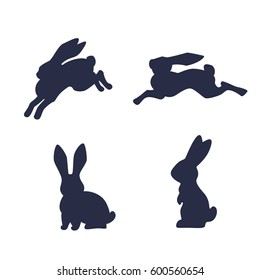 Running hare vector silhouette isolated on white background. Black and white rabbit silhouette set. Happy Easter rabbits outlines