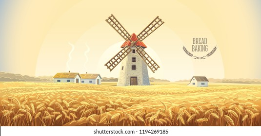 Rural autumn landscape with windmill and wheat field.