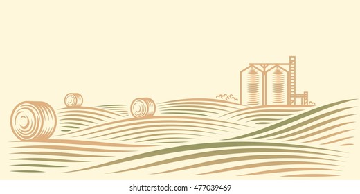 Rural landscape with fields, haystacks and grain elevator