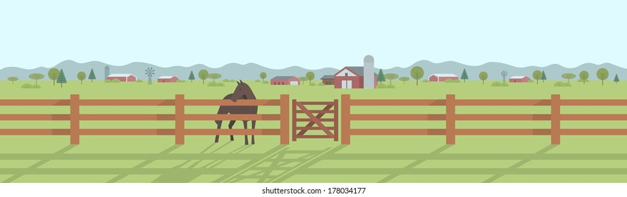 Rural landscape panorama. Horse standing behind the wooden fence at pasture land with houses and trees in the distance