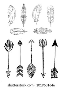 Rustic Ethnic boho style feathers and arrows. Vintage tribal and decorative arrows and feathers. Hand drawn vintage vector set.