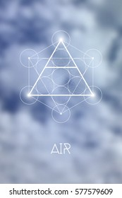 Sacred geometry Air element symbol inside Metatron Cube and Flower of Life in front of natural blurry background.
