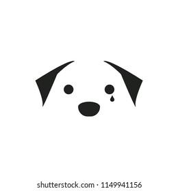 A sad dog, shedding a tear