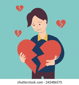 Sad man holding broken heart shape in concept of being broken heart.
