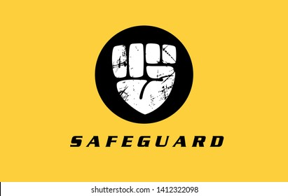 Safeguard security protection logo design with fist drawing and shield shape. Guard sign vector illustration  Bodyguard or service alarm icon concept.