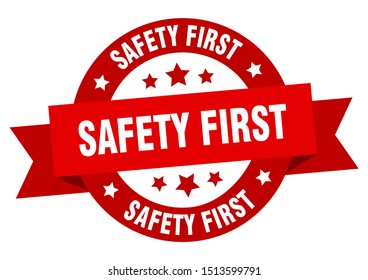 safety first ribbon. safety first round red sign. safety first