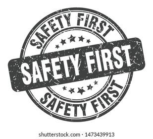 safety first stamp. safety first round grunge sign. safety first