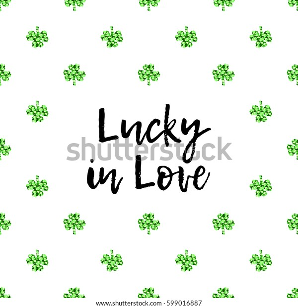 Saint Patrick's Day greeting card with sparkled green clover leaves and text. Inscription - Lucky in Love