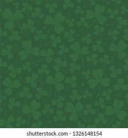 Saint Patrick's day seamless background in dark green with cloverleafs and stars. Shamrock irish background. For web, textile, wrapping paper, wallpaper, banner, card. Vector illustration.