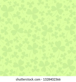 Saint Patrick's day seamless background in light green with cloverleafs and stars. Shamrock irish background. For web, textile, wrapping paper, wallpaper, banner, card. Vector illustration.
