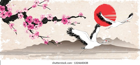 Sakura branch and flying herons on a background of Mount Fuji against the sun