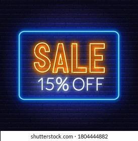Sale 15 percent off neon sign on brick wall background.