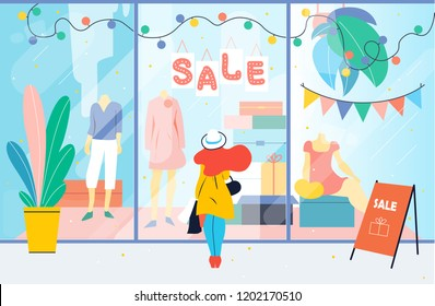 Sale. Girl looks at the clothes shop window. Woman standing near showcase in the mall. Discount