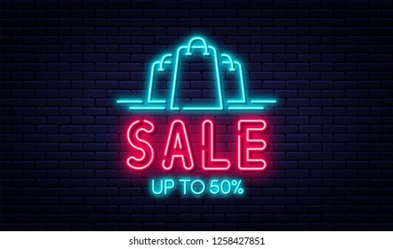 Sale neon sign, sale and discount concept. Bright and glowing neon sign for e-commerce, advertisement, banner, billboard. Shopping bags with text on brick wall background. Vector