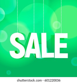 Sale paper poster with green background and bokeh