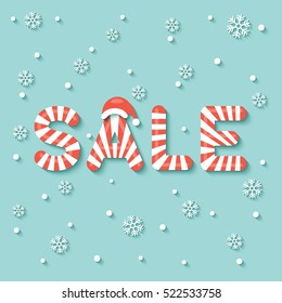 """""""SALE"""" sign in red and white Christmas sweet style on snow and snowflakes background."""