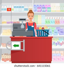 Saleslady woman cashier standing at checkout in supermarket.