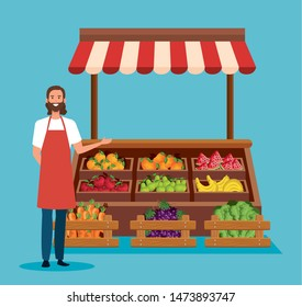 salesman with apron and healthy vegetables and fruits