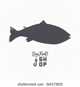 Salmon fish silhouette. Seafood shop logo branding template for craft food packaging or restaurant design. Vector illustration