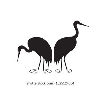 Sandhill Crane silhouettes, vector. Minimalist poster design. Two birds silhouettes illustration isolated on white background. Wall Decals, wall art work, graphic design