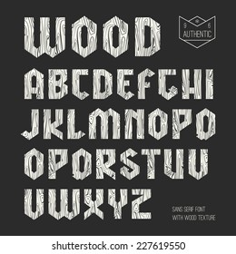 Sanserif  geometric font with wood texture. White font on black background