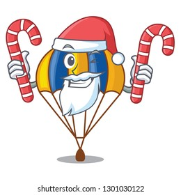 Santa with candy parachute in shape of acartoon fuuny