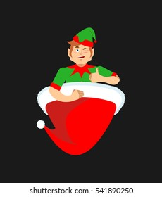 Santa cap and elf. Little Claus assistant. Christmas red hat
