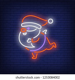 Santa Claus running neon sign. Christmas design. Night bright neon sign, colorful billboard, light banner. Vector illustration in neon style.