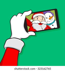 Santa Claus and snowman taking selfie using a smart phone