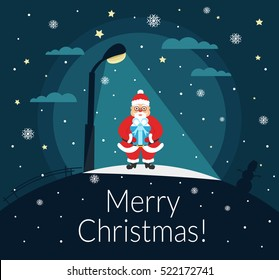 Santa Claus stands with a gift in the hands of the night under a street lamp. Merry Christmas and Happy New Year. Vector.