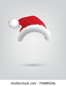 Santa hat isolated on grey background. Vector Christmas and New Year accessory.