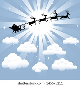Santa and reindeer silhouette flying through the sky