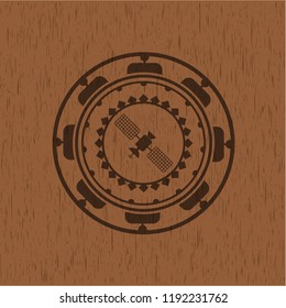 satelite icon inside badge with wooden background