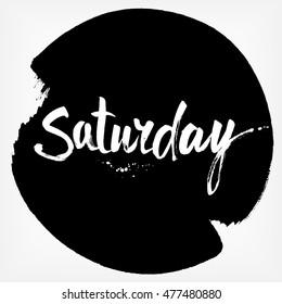 Saturday. Handwritten brush typography. Isolated calligraphy design element on black