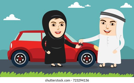 Saudi Woman or Girl being happy after getting Permission to Drive. Arab Husband or Man handing over the Car Keys to his wife. Female Drivers are allowed Driving License now.