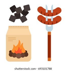 Sausages on a meat fork, charcoal for fire in the package and pile of coals vector flat material design isolated on white