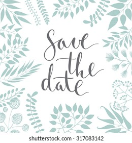 Save the date, ink hand lettering. Floral elements.