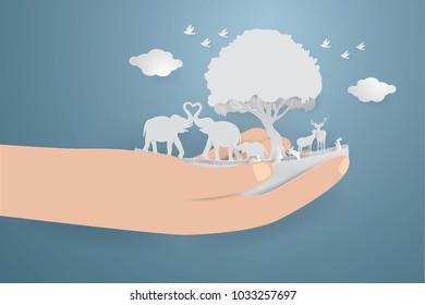 Save Wildlife concept.wild animals on hand,paper craft style