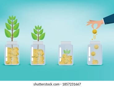 Saving  money. A hand putting coins in bottle on blue background. The coins in the bottle for save money.investment,bank,finance,Photo financial saving and Saving .