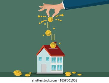 Saving  money. A hand putting coins in home model.The coins in the home for save money.investment,bank,finance,Photo financial saving and Saving .
