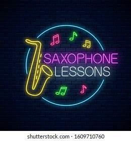 Saxophone lessons glowing neon poster or banner template. Music instrument training advertising flyer with circle frame in neon style on dark brick wall background. Vector illustration.